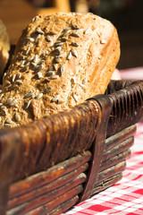 Freshly baked loaf of break in a wooden basket
