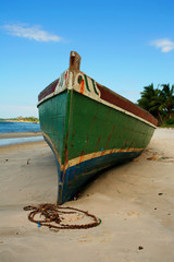 Big dhow resting on the beach, waiting for high tide