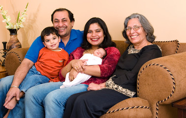 An East-Indian family sits in their living room