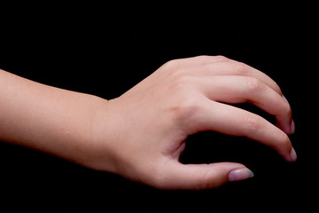 A hand on black background