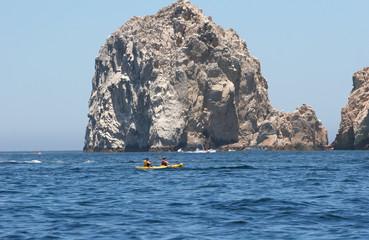 Kayak Past Rocks