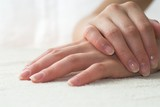 Nice hands on white towel. Soft manicure. poster