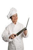 female chef sharpening knives