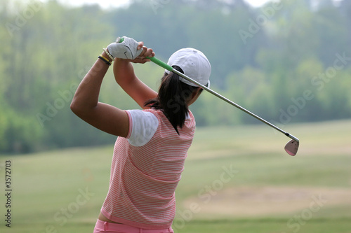 Lady golf swing action at practice