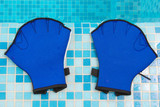 Aqua gloves lie on the coast swimming-pool poster