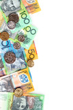 Australian notes and coins form a border on white. poster