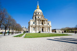 Les Invalides in Paris, France with a blue sky background poster