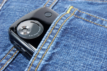pda phone in blue jeans pocket