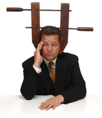 Businessman with a vice on his head