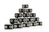 Nine volt batteries forming a pyramid. poster