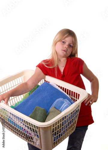Young girl with laundry basket annoyed
