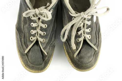 Worn and dirty pair of shoes
