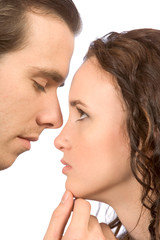 young female in tears comforted by her boyfriend