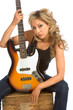 Portrait of Girl sitting on the box with bass guitar