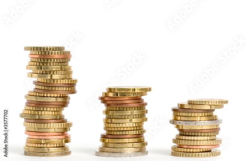 Three stacks of euro coins on white background