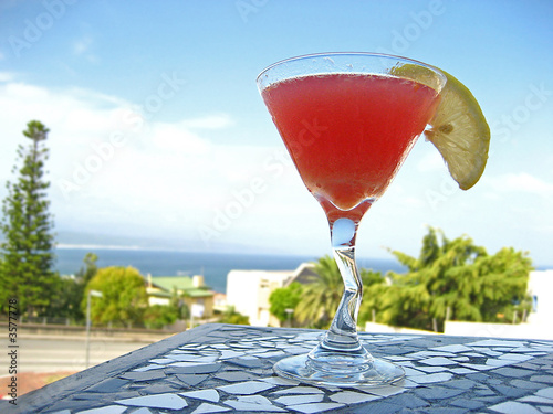 Red cocktail on table