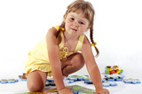 Young girl and puzzles poster