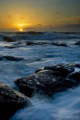 Misty sea sunset