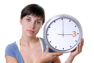 Caucasian young woman holding a big clock