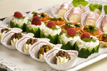 Small snacks on a plate ready to be served at the party