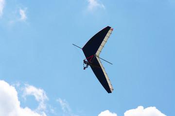 Single paraglider against azure sky