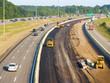 Leinwanddruck Bild - Asphalt being laid on freeway construction project