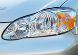Close-up of headlight on an automobile poster