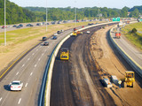 Asphalt being laid on freeway construction project