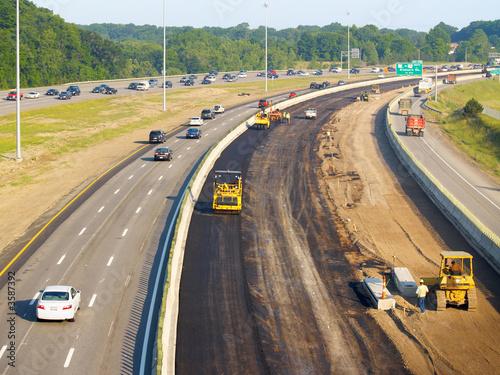 Leinwanddruck Bild Asphalt being laid on freeway construction project