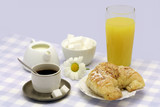Almond croissant with a good cup of coffee and orange juice. poster
