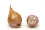 Two shallots close-up. One is peeled and cut poster