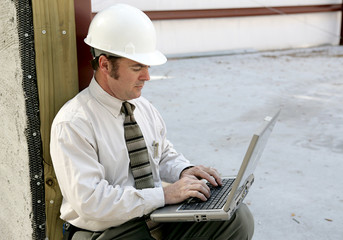 engineer  using a laptop computer.