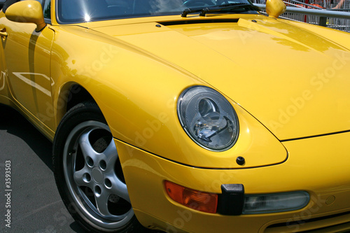 Foto op Canvas Snelle auto s Bright Yellow Sports Car