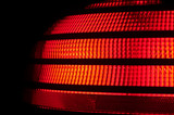 red plastic automobile tail light. poster