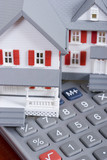 Mortgage and down payment - house and calculator poster