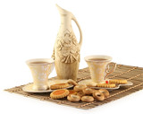 On a wooden napkin two cups with tea and a jug cost.   poster