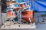 A drum kit on stage poster