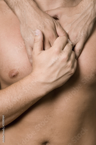 A homosexual couple, closeup of a body