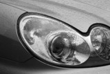 Shiny car with silver paint. Water drops on the hood. Car lamp. poster