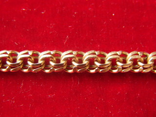 Gold Chain on Red