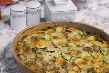 Zucchini Casserole made with Sausage, Cheese, and Onions.
