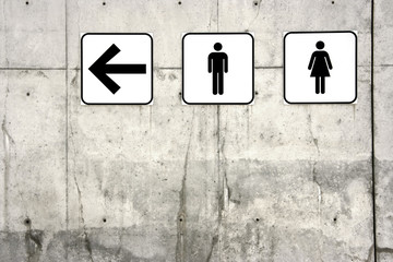 Male and female toilet signs (left arrow)