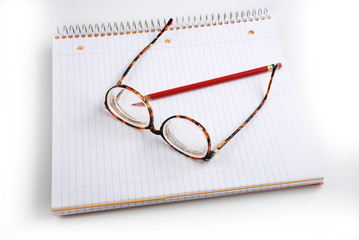 Pictures of glasses resting on a notepad,