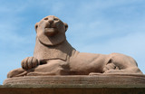 stone lion statue of alert female animal poster