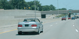 Convertible automobile speeding on the highway poster