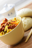 Chinese noodles with beef and pasty close-up poster
