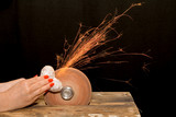 Woman hands grinding a heart shaped metallic object poster
