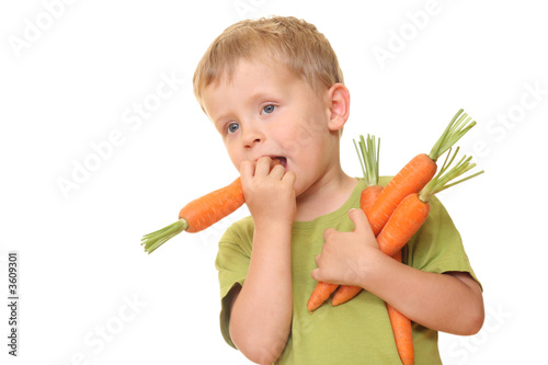 three years old boy eating fresh carrot isolated on white - 3609301
