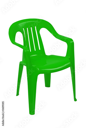 green plastic chair on white