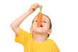 five years old boy eating fresh carrot isolated on white